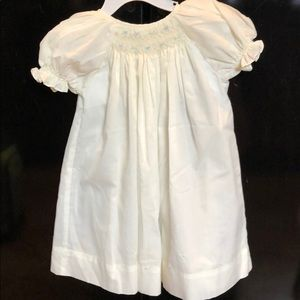 Yellow smocked baby dress